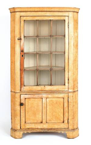 Pennsylvania painted poplar onepiece corner cupboard early 19th c