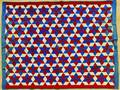 Two star pattern pieced quilts