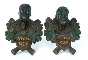 Pair of black forest plaques with black male busts