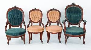 Four Victorian chairs with carved mask crests
