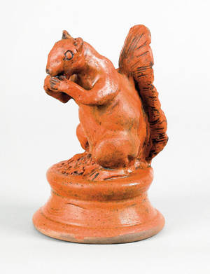 Large Pennsylvania redware figure of a squirrel 19th c