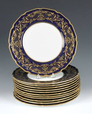 Set of twelve Royal Doulton porcelain plates with cobalt border and gilt decoration