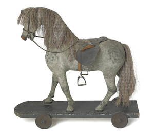 Carved and painted horse riding toy 19th c