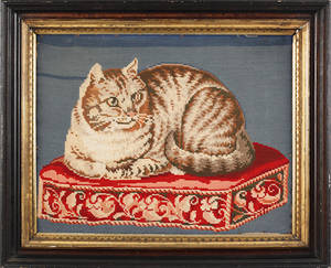 Victorian pictorial needlework of a cat resting on a pillow