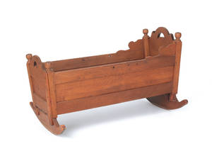 Pennsylvania walnut cradle with crescent cutouts