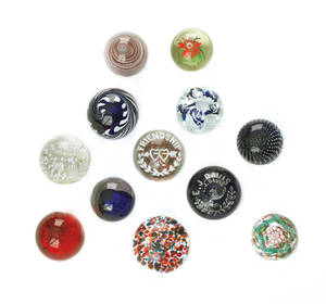 Collection of twelve glass paperweights