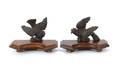 Pair of rosewood and mahogany bird wall mounts