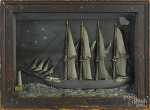 Carved and painted ship diorama of the