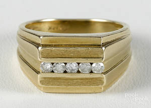 Gold and diamond ring with a 14K yellow gold band with a row of five full cut diamonds