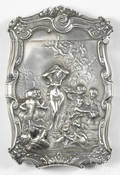 Heavily embossed sterling silver match vesta safe with nude woman emerging from a seashell in the water and cherubs in the background sky