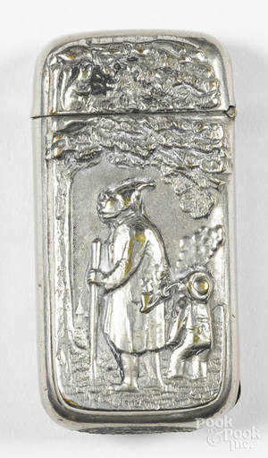 Heavily embossed nickel silver match vesta safe having a gnome with a walking stick and pipe