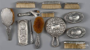 Group of sterling silver mounted dresser articles
