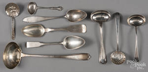 Assorted silver serving spoons and ladles