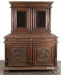 Renaissance style carved walnut twopart cupboard