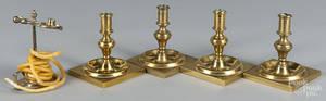 Four English brass candlesticks