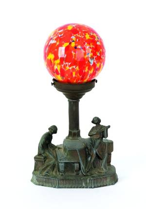 Spelter figural table lamp with glass globe