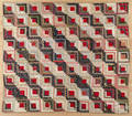 Pieced log cabin quilt