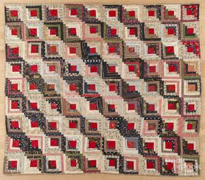 Pieced log cabin quilt