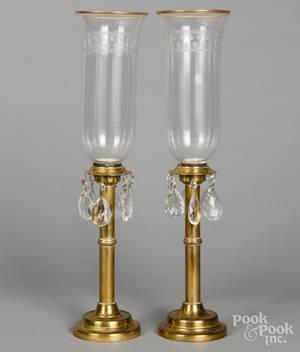 Pair of brass hurricane candlesticks