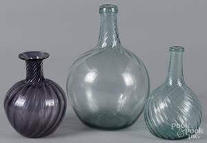 Two blown aqua glass swirl bottles