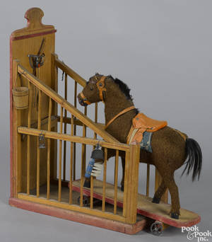 German painted pine horse stall with a horse pull toy