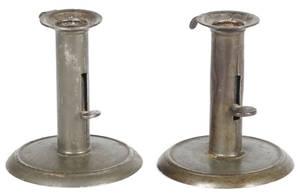 Pair of tin hogscraper candlesticks