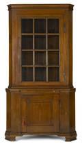 Pennsylvania walnut twopart corner cupboard late 18th c