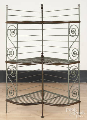 American cast iron and brass bakers rack