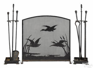 Wrought iron fireplace screen andirons and fire tools early 20th c