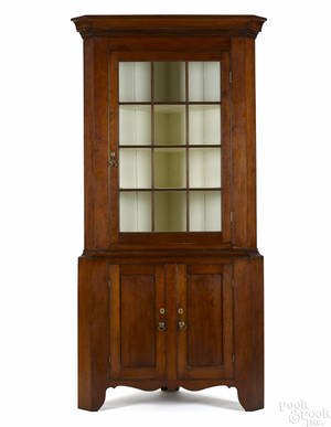 Pennsylvania Federal twopart cherry corner cupboard early 19th c