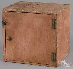 Small painted pine table top cupboard in salmon paint