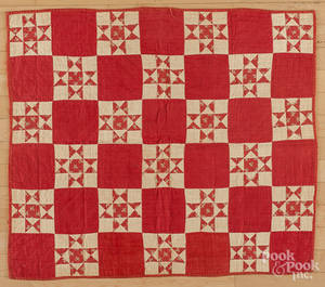 Red and white pieced crib quilt