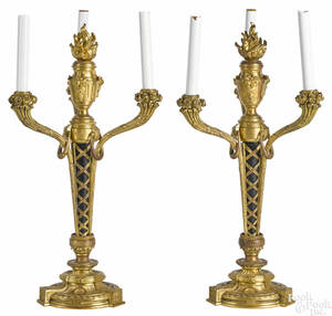 Pair of French Empire gilt bronze threelight candelabra