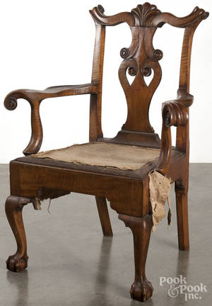 Boldly carved Chippendale style tiger maple armchair with a shell carved crest and ball and claw feet