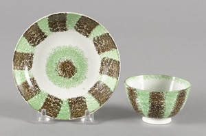 Green and brown rainbow spatter cup and saucer 19th c