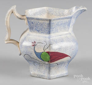 Blue spatter pitcher with peafowl decoration