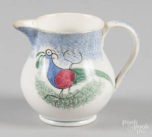 Blue spatter creamer with teal peafowl decoration