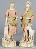 Pair of Royal Dux bisque figures of a young man and woman