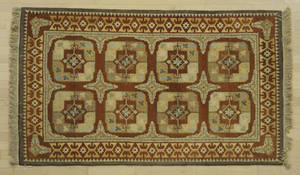 Semi antique throw rug