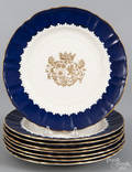 Set of eight Masons Ironstone plates with central gilt armorial and blue border