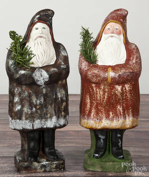 Two large contemporary chalkware belsnickle Santa Claus figures