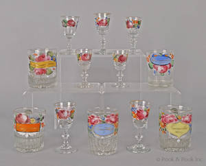 Twelve enamel decorated colorless glasses