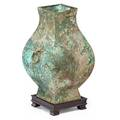Archaic chinese bronze vase on stand