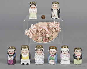 Group of eight porcelain figural toothpick holders