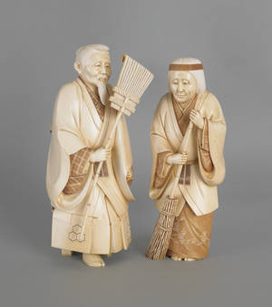 Pair of Japanese carved elephant ivory of a man and woman