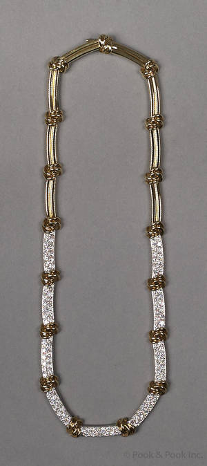 18K yellow gold and diamond necklace with alternating gold knots and pave set diamonds