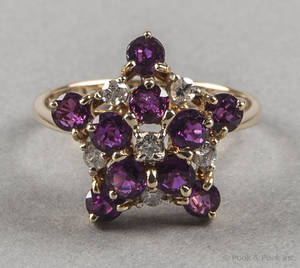 14K yellow gold ruby and diamond ring with a star motif