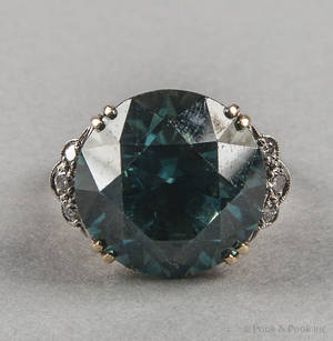 14K yellow gold zircon and diamond ring in a high setting containing a large round cut bluishgreen zircon