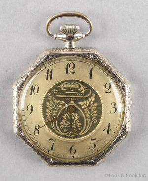 14K white gold Waltham swingout style octagonal form pocket watch with an open face case and seventeen jewels
