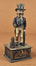 Cast iron  Uncle Sam  mechanical bank manufactured by Shepard Hardware Co